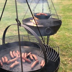 Shropshire Hills Catering barbecue sausage using our new Kadai fire-bowls