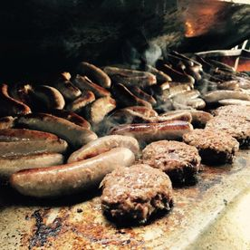Shropshire Hills Catering homemade sausage and burgers on the barbecue
